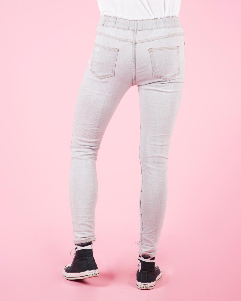 Jeans strappati elasticizzati a vita
